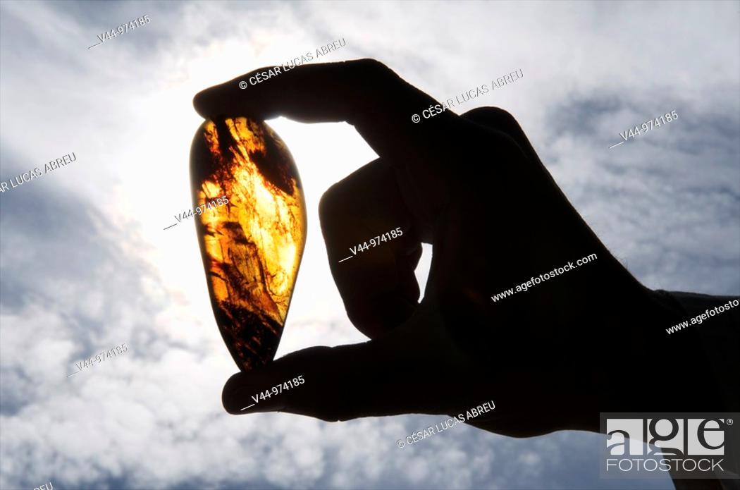 """Stock Photo: Piece of amber found in the """"Cueva del Soplao"""", Valle del Nansa, Cantabria, Spain."""
