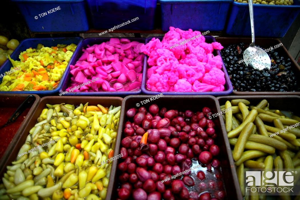Stock Photo: Olives and other delicacies at a market in the old city section of Jerusalem.