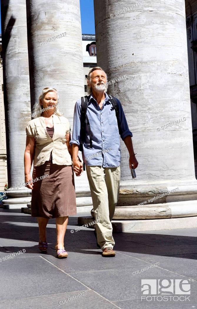 Stock Photo: Couple walking together.