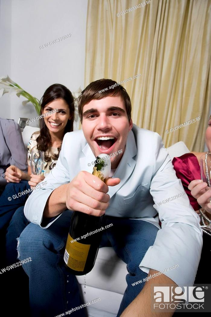 Stock Photo: Portrait of a young man with her friends celebrating a party.