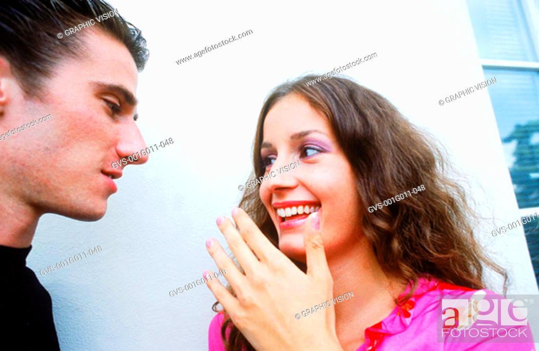 Stock Photo: Young couple talking.