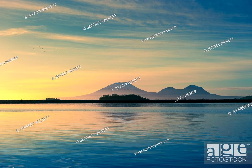 Stock Photo: Kruzof Island and Mount Edgecumbe on a calm evening west of Sitka, Alaska, USA. Kruzof Island is an island in the Alexander Archipelago in southeastern Alaska.