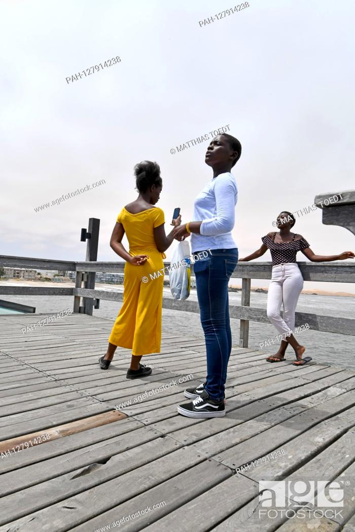 Stock Photo: Young Namibians on the Seebruecke in Swakopmund, taken on 02.03.2019. Photo: Matthias Toedt / dpa-Zentralbild / ZB / Picture Alliance | usage worldwide.