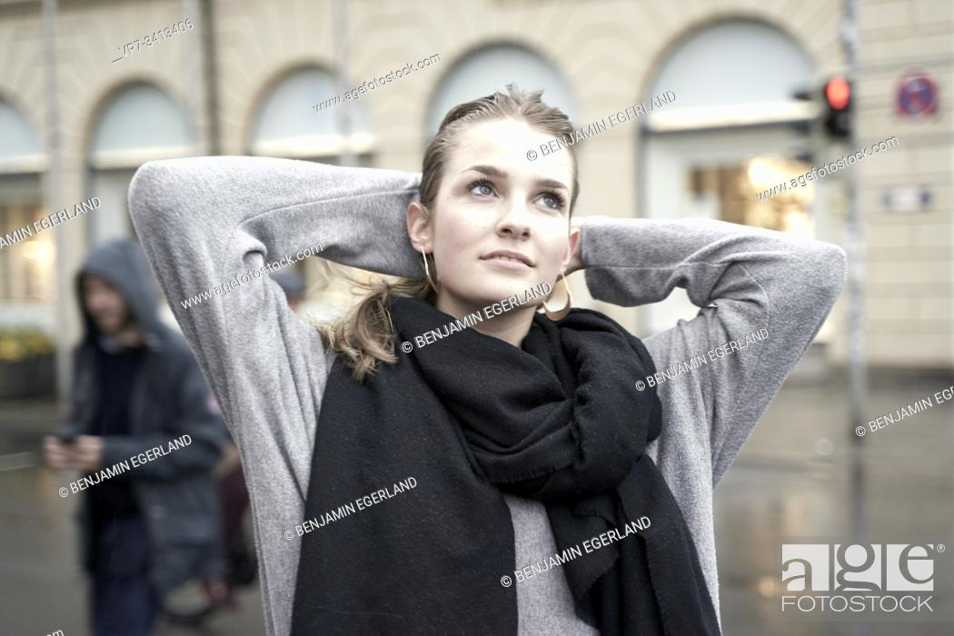 Photo de stock: Young woman at street in city, rainy weather. Munich, Germany.