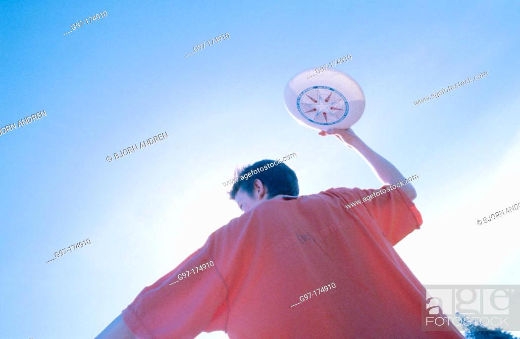 Stock Photo: Throwing frisbee.