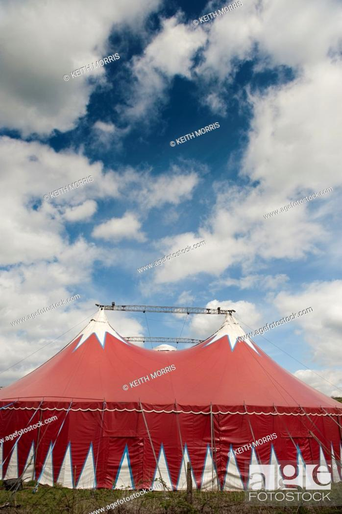 Stock Photo: The Big Kid travelling circus red coloured big top tent, visiting Aberystwyth Wales UK.