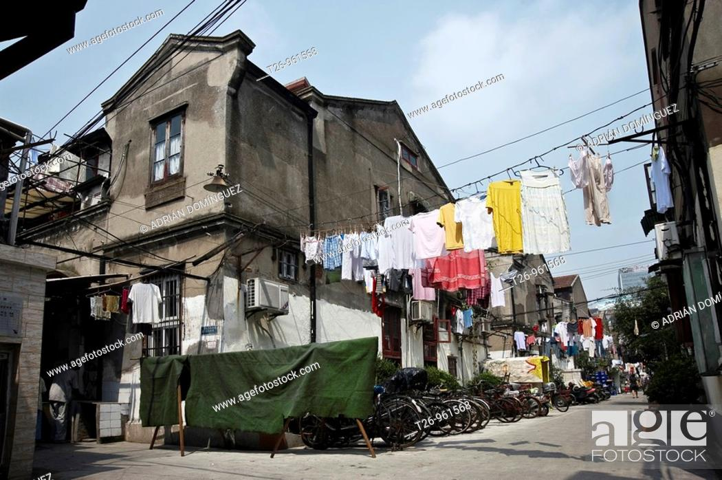 Stock Photo: Clothes hung on a street of the Old City. Shanghai, China.