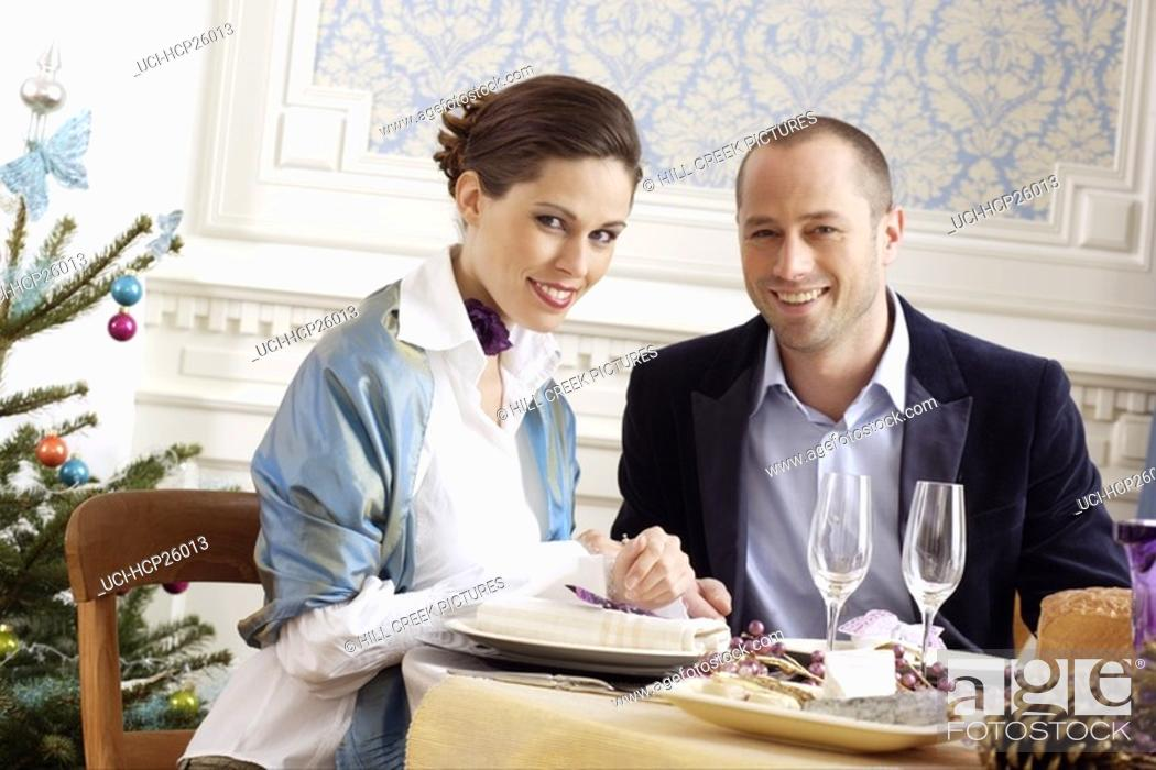 Stock Photo: Couple eating at restaurant.