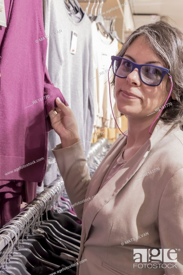 Stock Photo: Woman in a Clothes Store.
