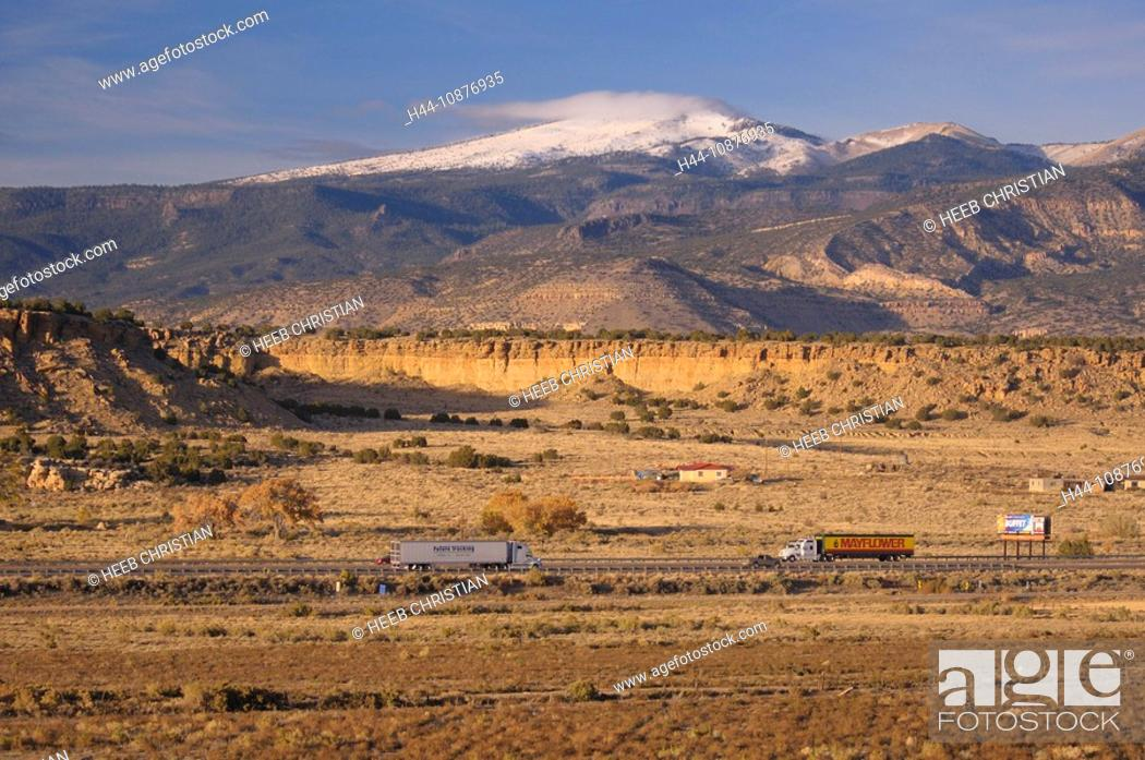 Stock Photo: Interstate I-40 and snow covered Mountains, San Fidel, New Mexico, USA.