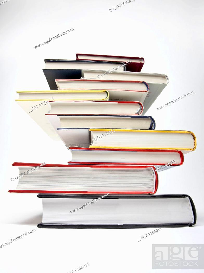 Stock Photo: A stack of various hardcover books, diminishing perspective.