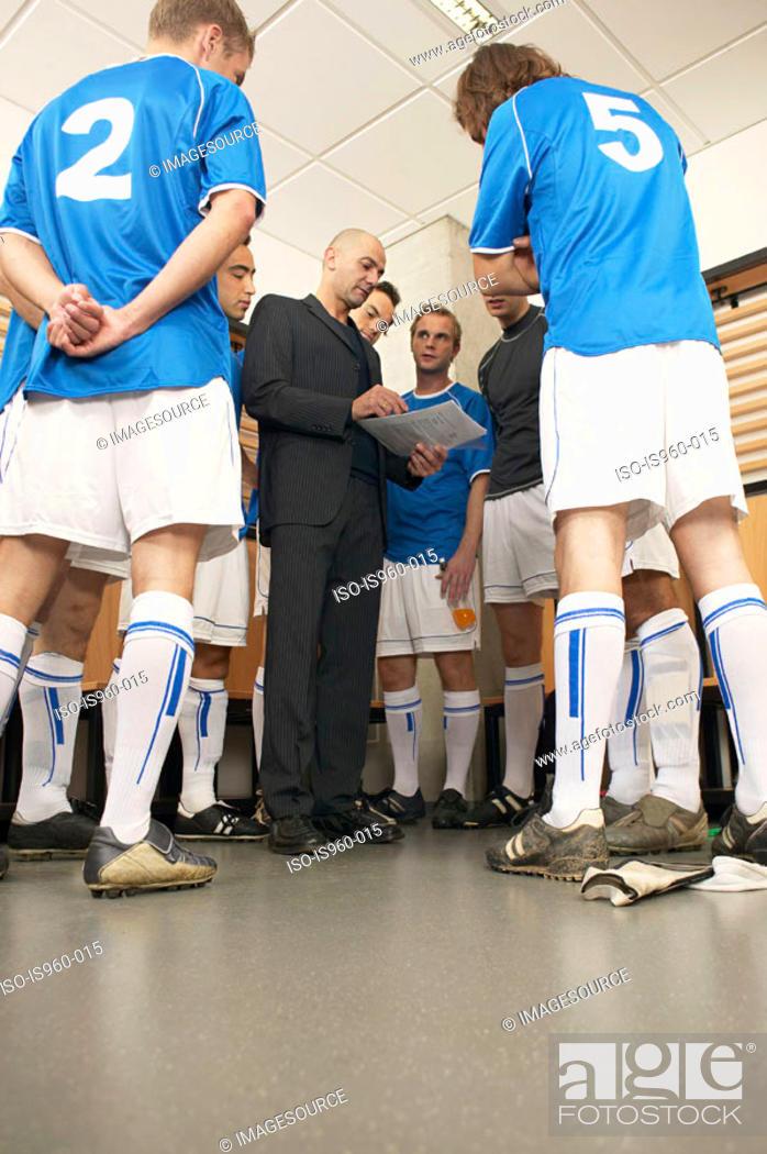 Stock Photo: Coach with football team.