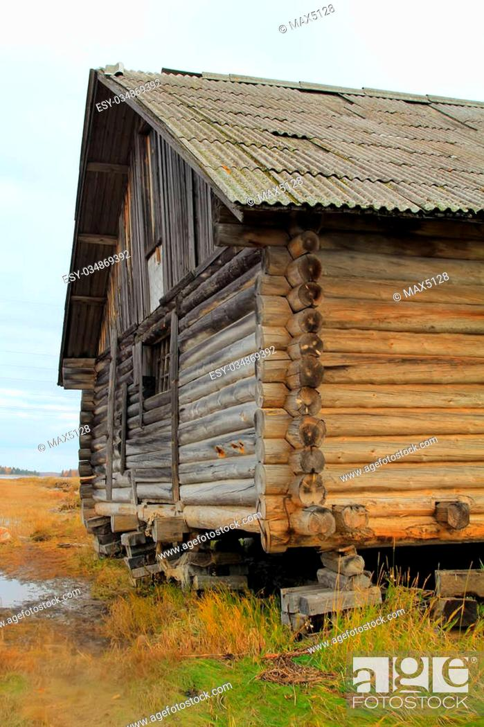 Stock Photo: Old fisherman's shed in North of Russia. Pomors chopped house. White sea.