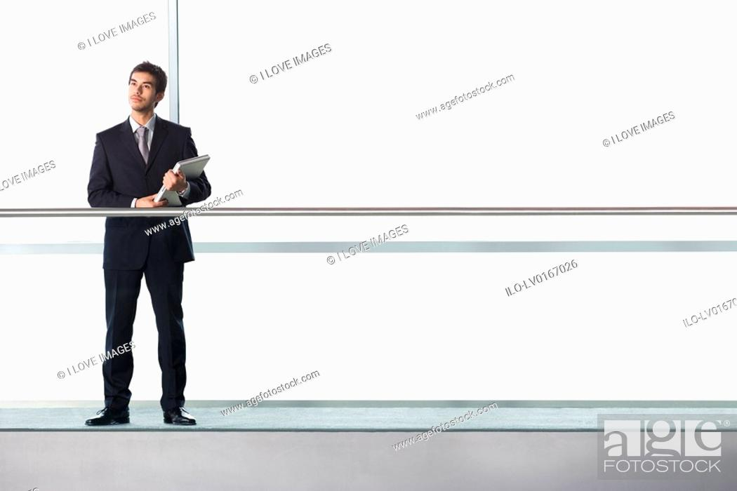 Stock Photo: Businessman in modern office building.
