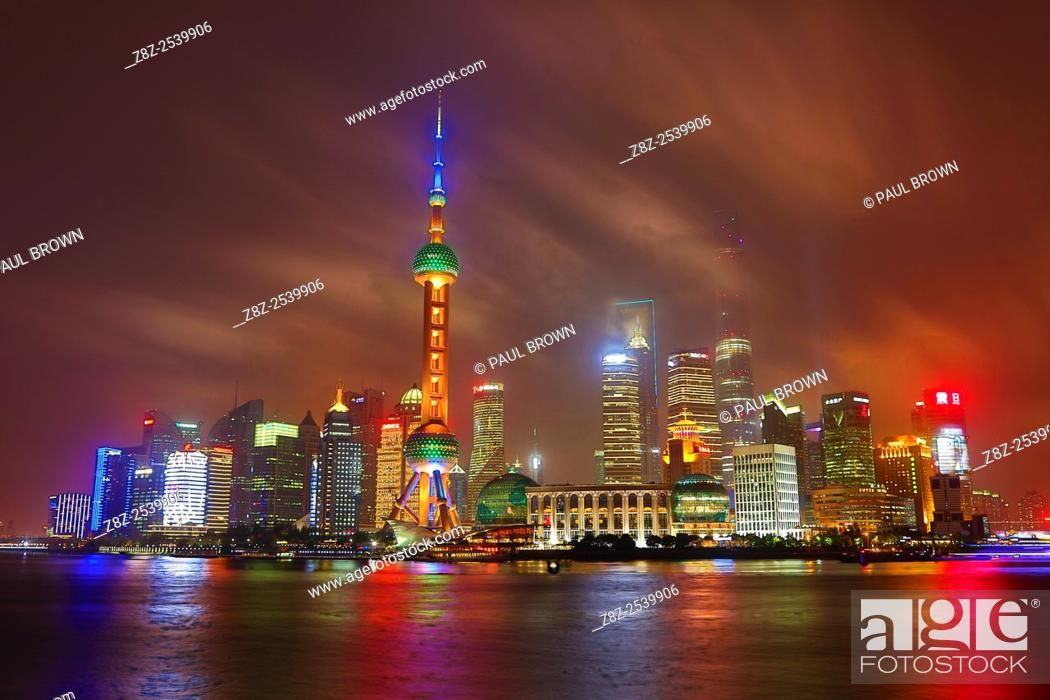 Stock Photo: General view of the Pudong city skyline in Shanghai at night with the Oriental Pearl TV Tower, Shanghai, China.