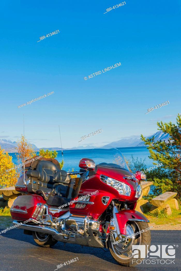 Stock Photo: Red motorbike by the ocean, Troms, Norway.