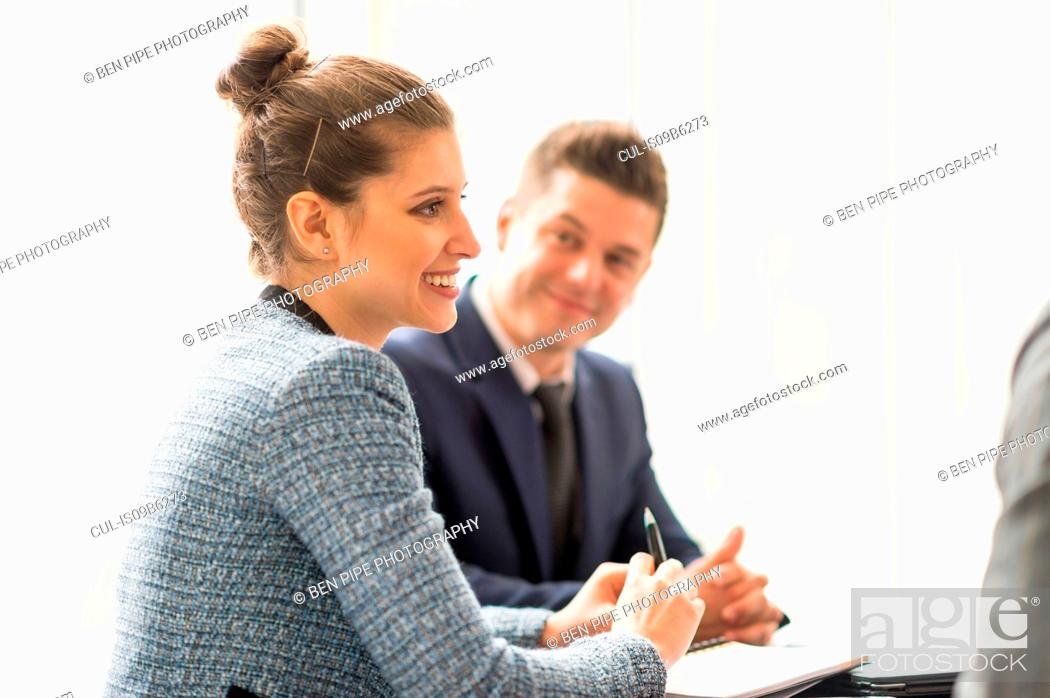 Stock Photo: Businesswoman and man in office meeting.