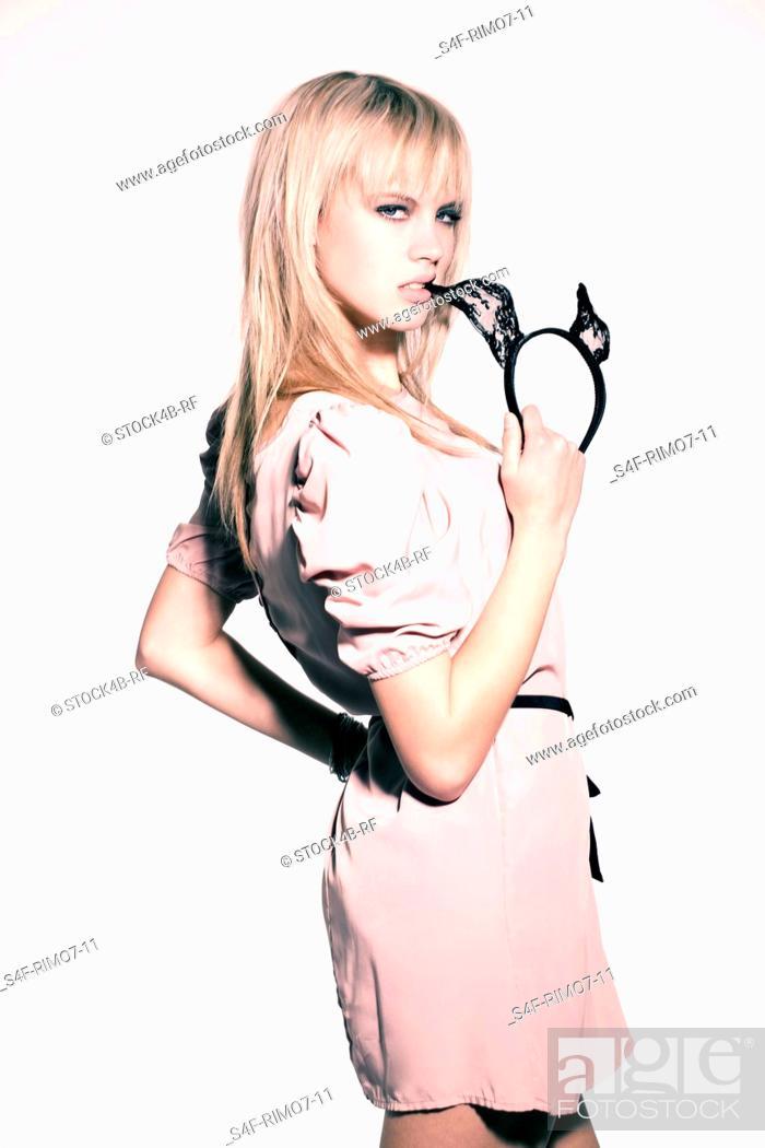 Stock Photo: Teenage girl wearing mini dress.