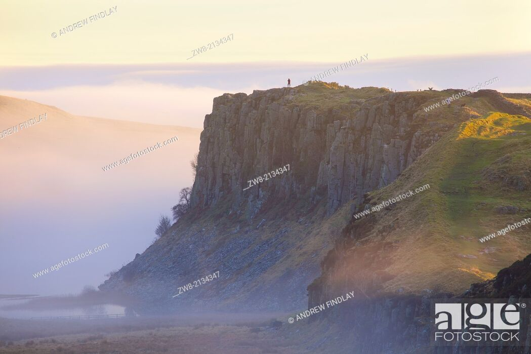 Stock Photo: Highshield Crags in the Mist from Steel Rigg Hadrian's Wall. Northumberland England United Kingdom.
