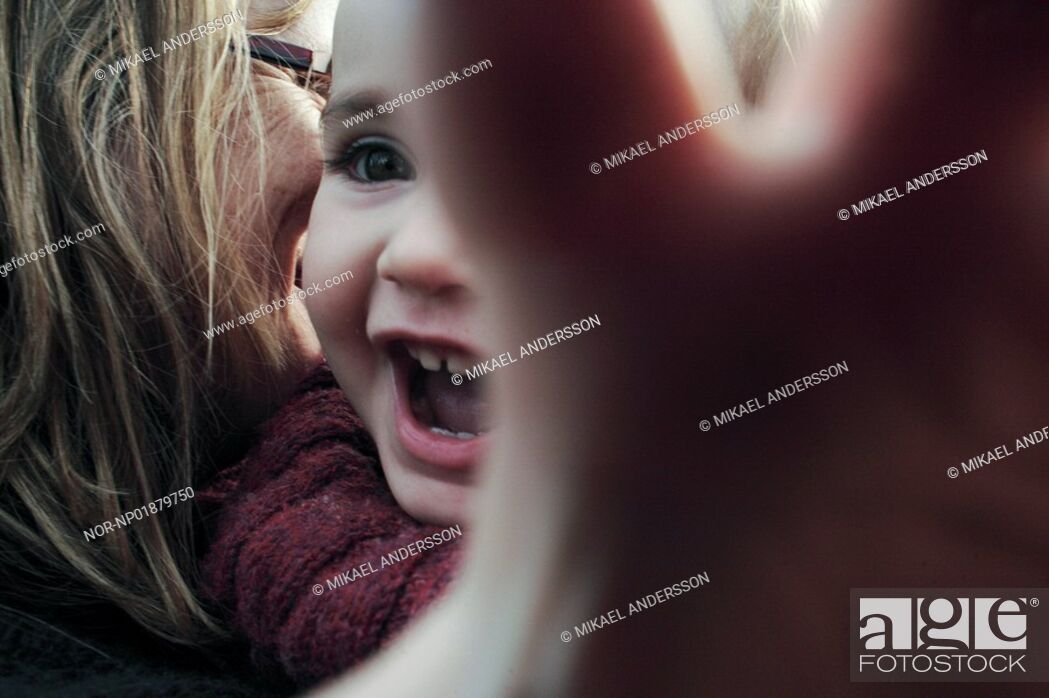 Stock Photo: Close-Up of mother and child laughing.