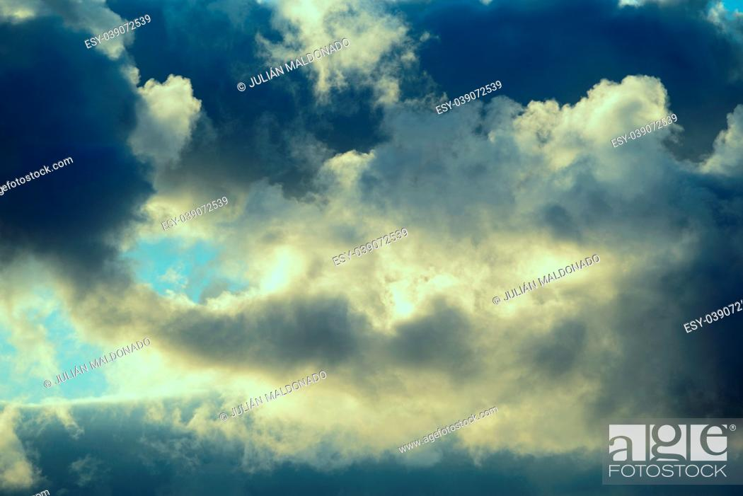Stock Photo: Clouds illuminated by the Sun in backlight.