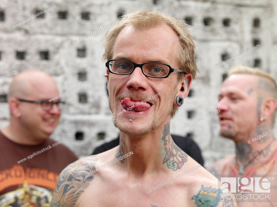 Stock Photo: Showing off spilt tongue piercing and Tattoos, Reykjavik, Iceland.