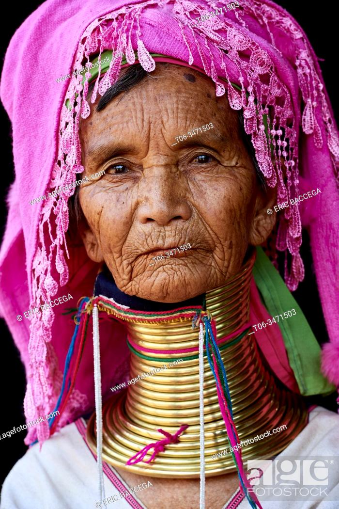 Stock Photo: Head portrait of a Kayan Lahwi woman with brass neck coils and traditional clothing. The Long Neck Kayan (also called Padaung in Burmese) are a sub-group of the.