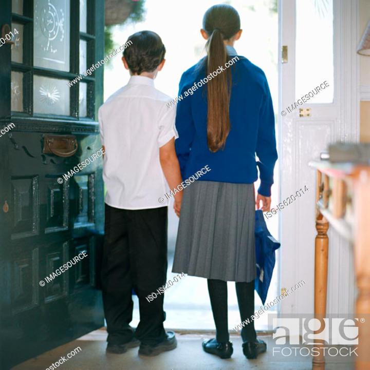 Stock Photo: School children standing in doorway.