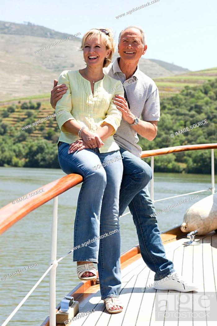Stock Photo: Senior couple enjoying a boat holiday.
