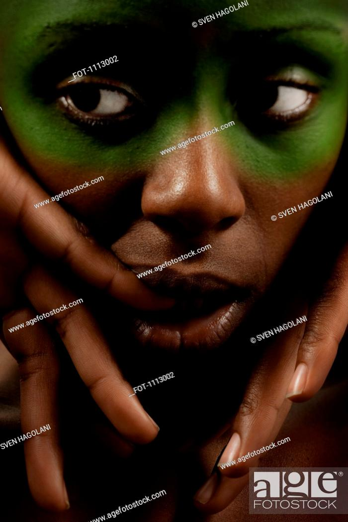 Stock Photo: Close-up portrait of a woman looking to the side with uncertainty.