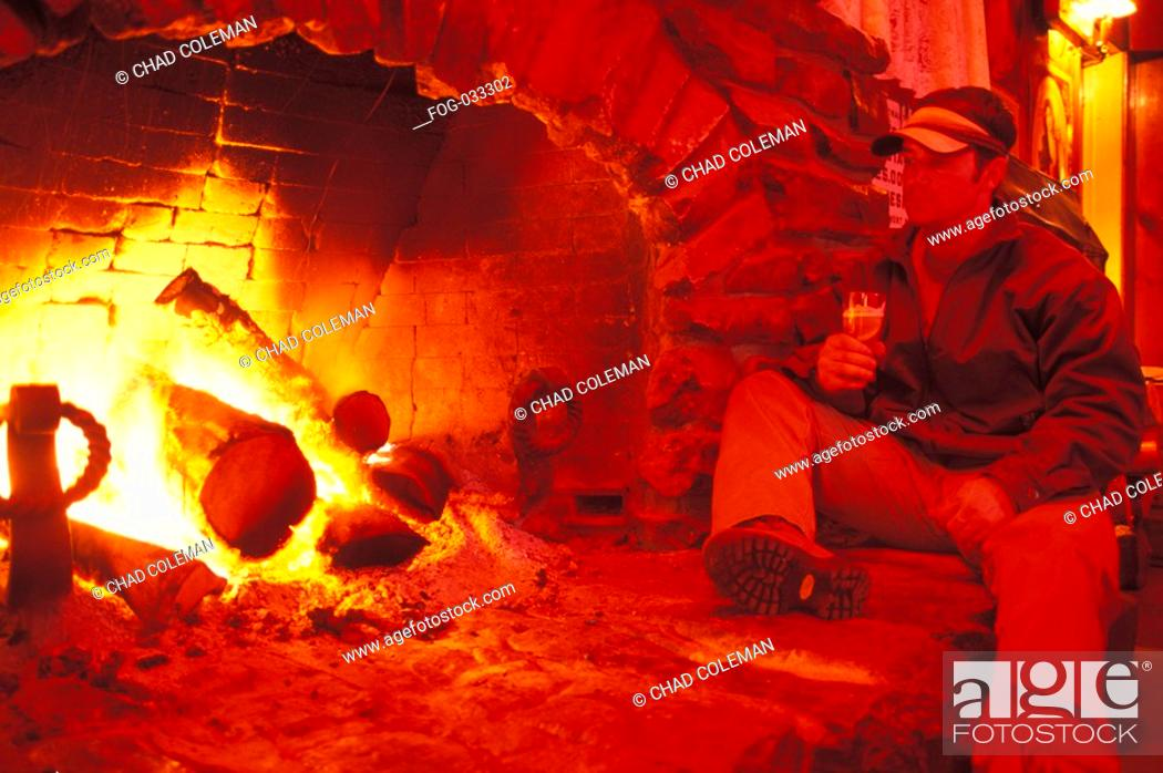 Stock Photo: Man with Beer by Open Hearth.