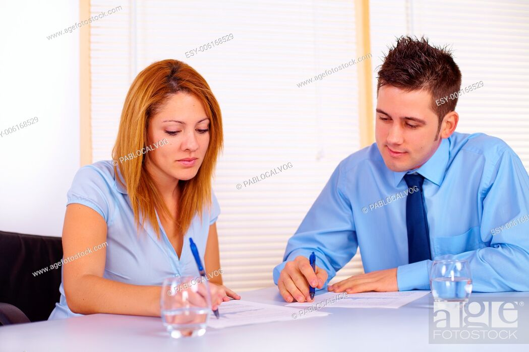 Stock Photo: Portrait of two business people working on the office.
