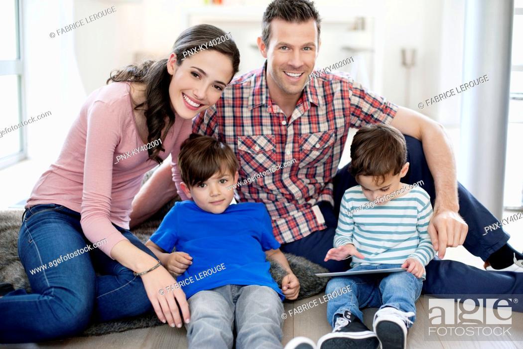 Stock Photo: Portrait of a happy family.