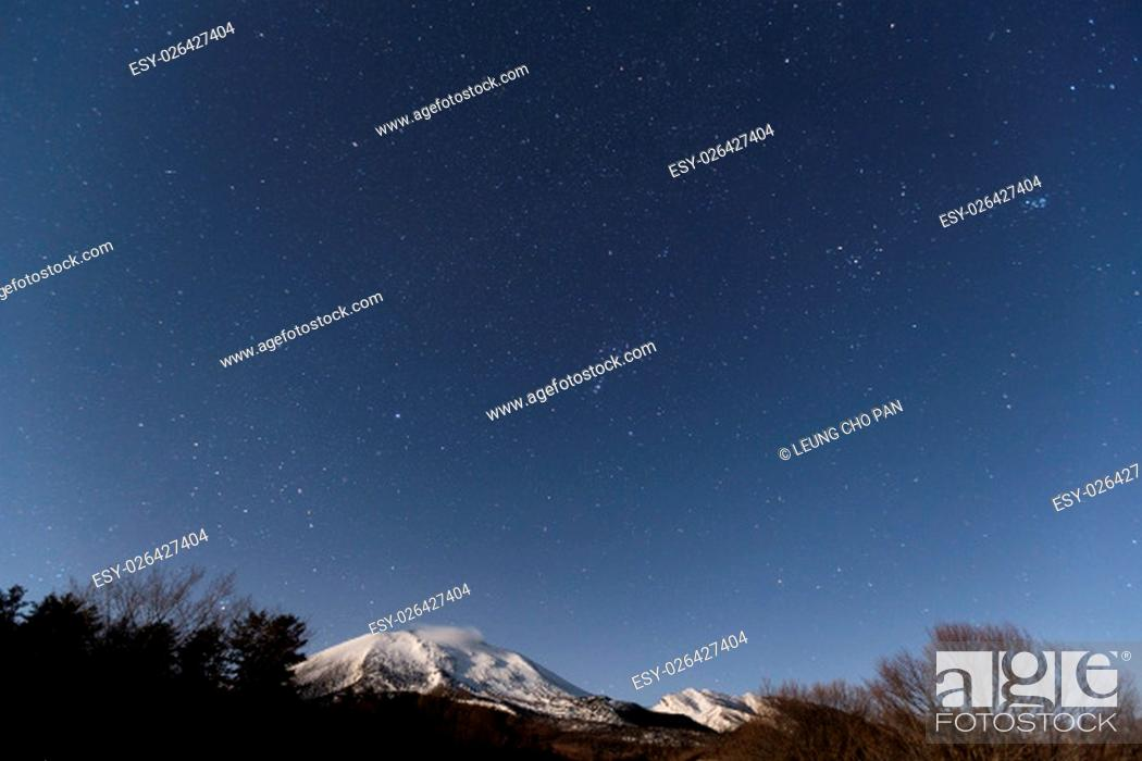 Stock Photo: Starry night and mountain.
