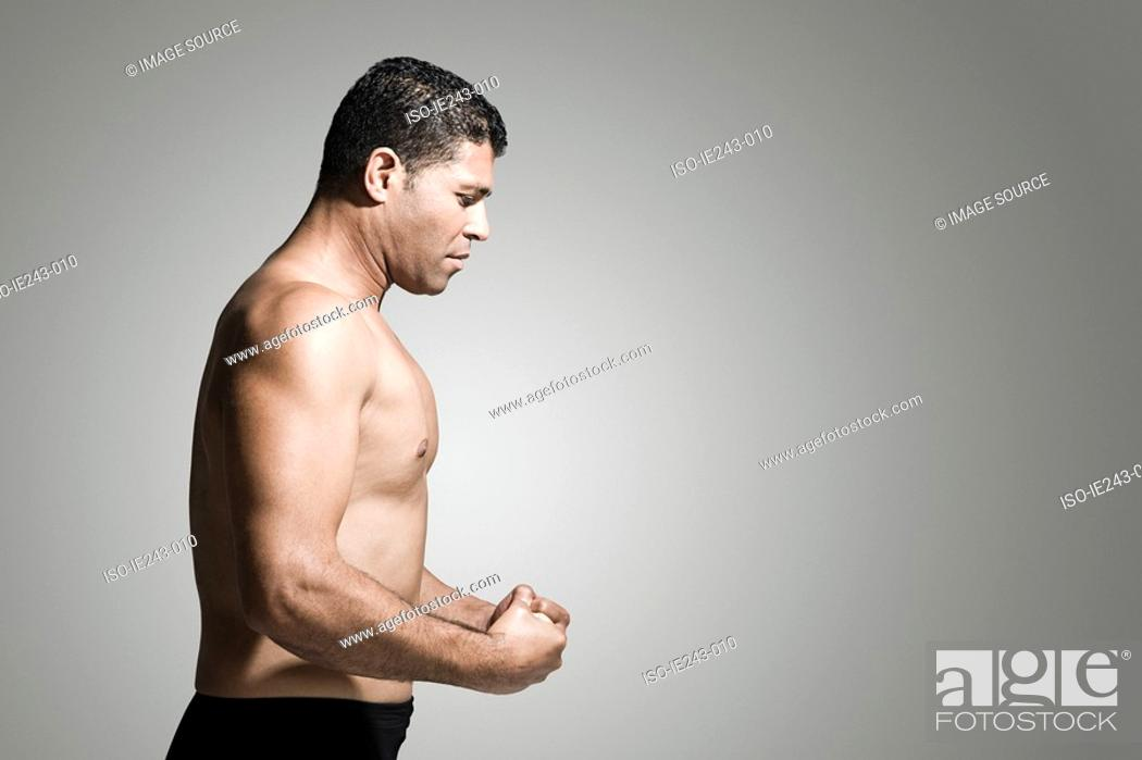 Stock Photo: Profile of a muscular man.