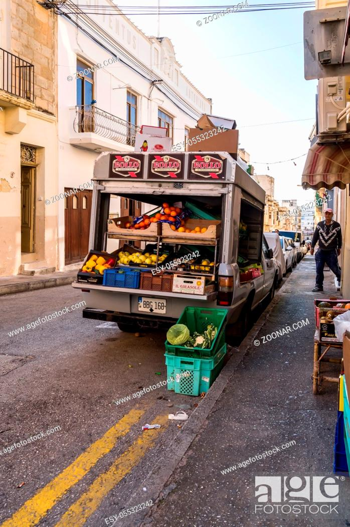 Stock Photo: La Vallette, Malte, Europe-30/11/2019.Small truck filled with vegetables and fresh fruits for sale in the streets of Cefalu in Sicily.