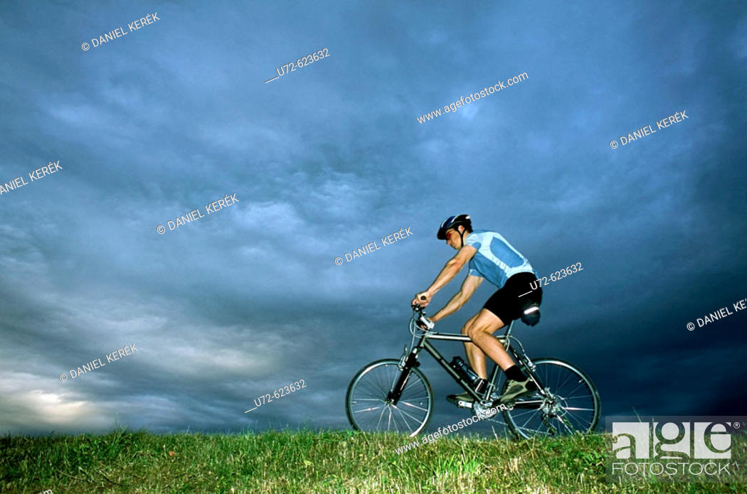 Stock Photo: Young man riding a mountain bike.
