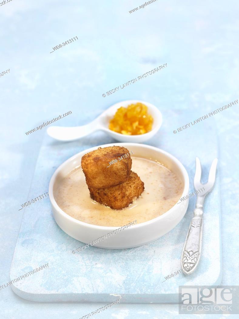 Imagen: Croquetas de arroz con leche con crema de turrón y naranja caramelizada / Milk rice croquettes with caramelized nougat cream and orange.