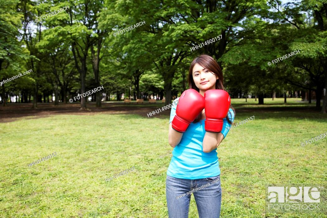 Stock Photo: Woman who does a boxing-exercise.