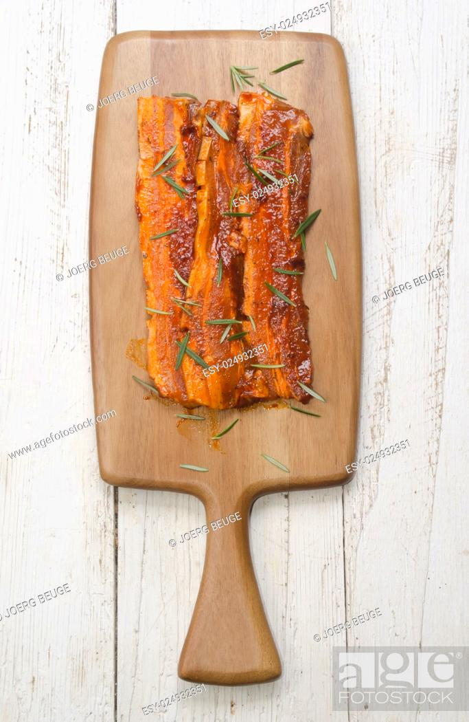 Stock Photo: paprika marinated pork belly with rosemary on wooden board.