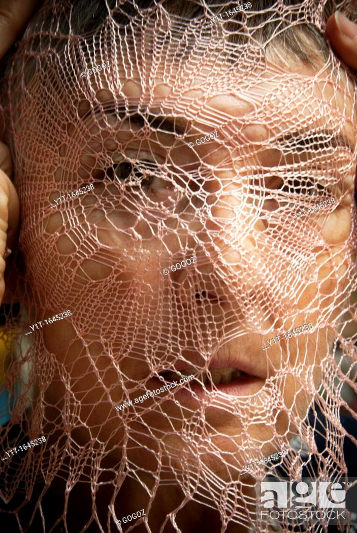Stock Photo: face with tissue of crochet, concepts.