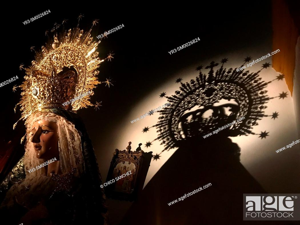 Stock Photo: The shadow of the crown of an image of the Virgin Mary is displayed in a church during Semana Santa in the church of Prado del Rey, Sierra de Grazalema.