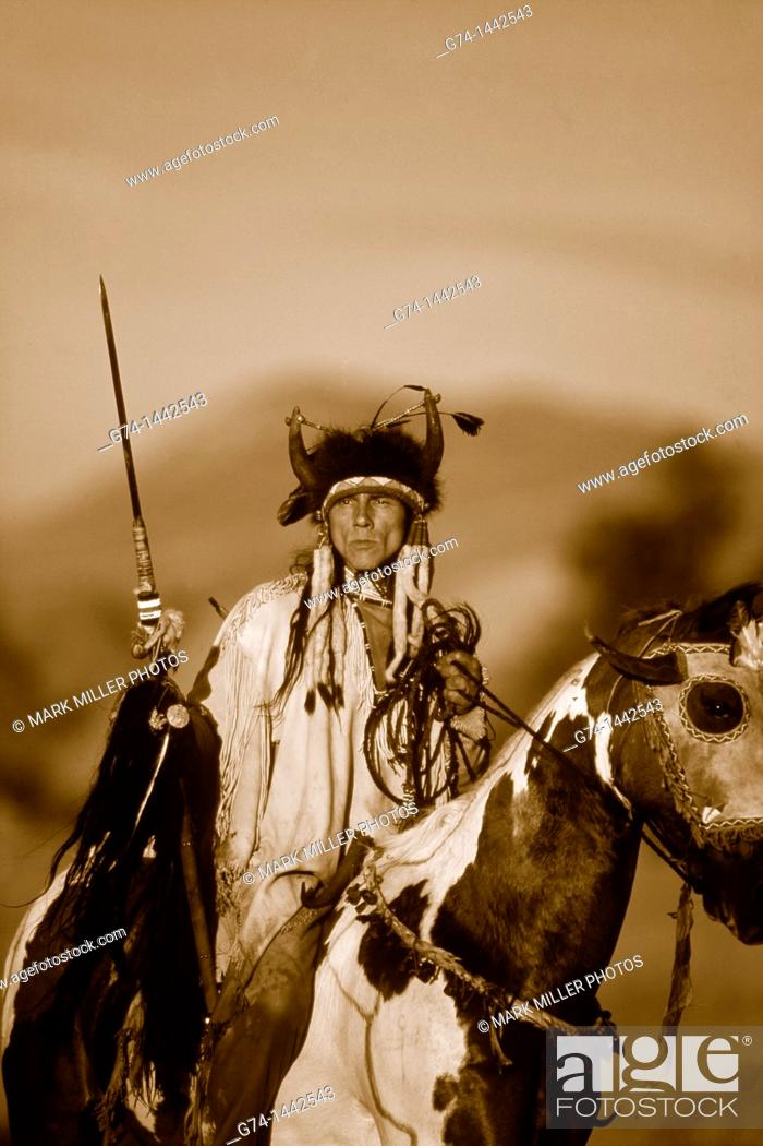 Stock Photo: Native American Riding on Horseback Re-enactment Model Released.