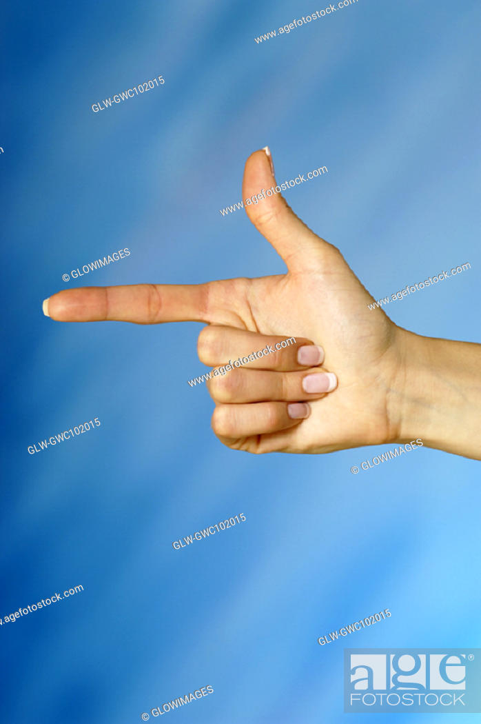 Stock Photo: Close-up of a woman's hands pointing a finger.