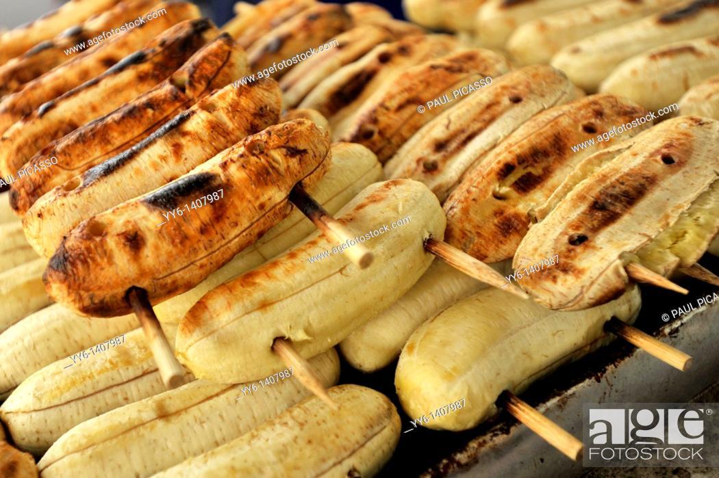Stock Photo: thai bbq bananas, Traditional Thai food cooked on an open charcoal stove, street market , Bangkok, thailand.