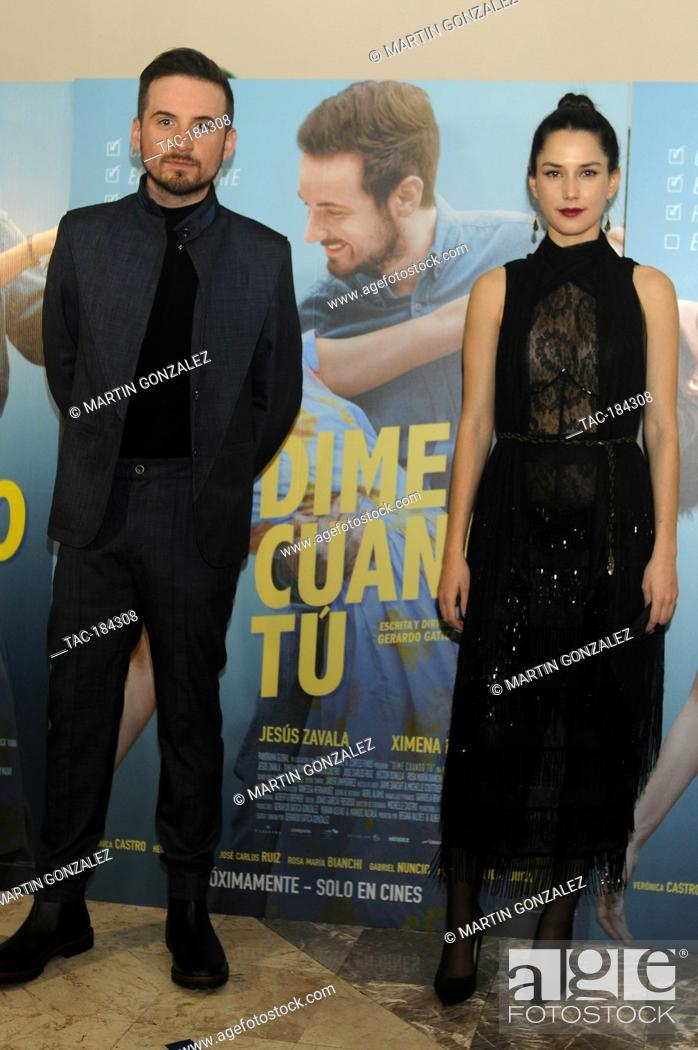 Stock Photo: MEXICO CITY, MEXICO ñ DECEMBER 14: Jesus Zabala and Ximena Romo pose for photos during the red carpet of film premiere Dime Cuando Tu at Cinepolis Diana on.