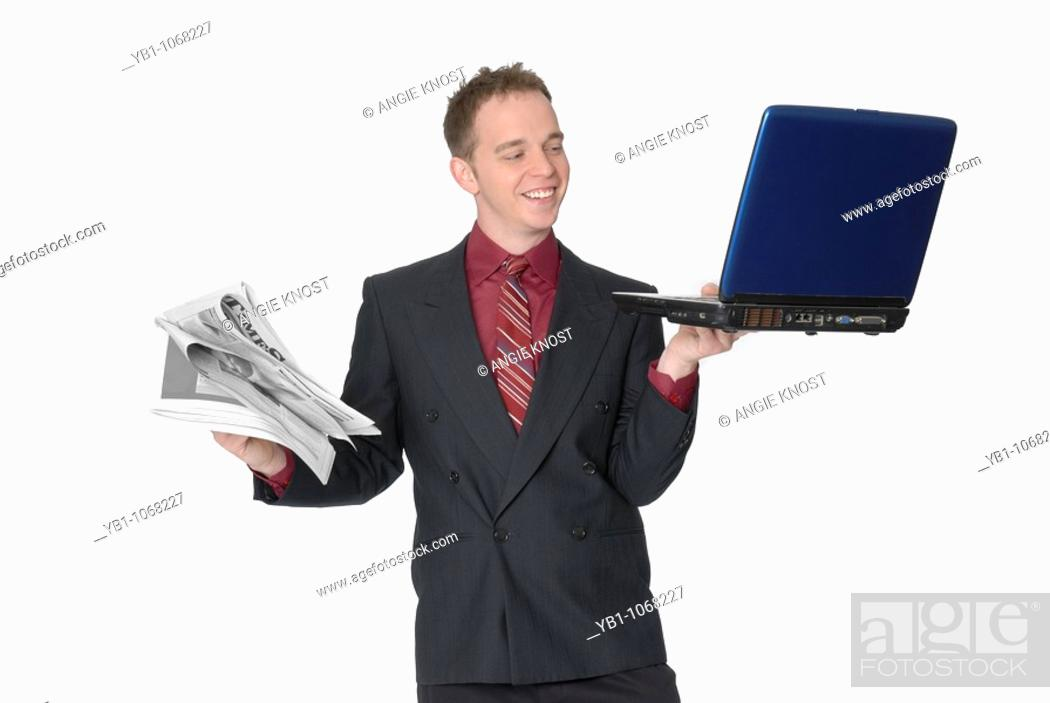 Stock Photo: Business man with laptop and newspaper.
