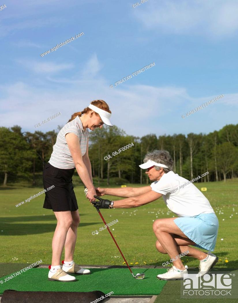 Stock Photo: Two women at driving range.