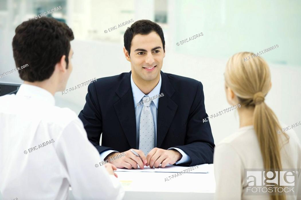 Stock Photo: Meeting between professional and clients.