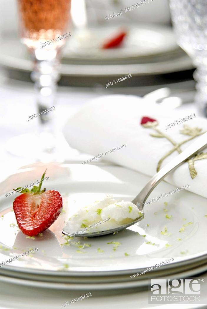 Stock Photo: Lemon sorbet garnished with strawberries.